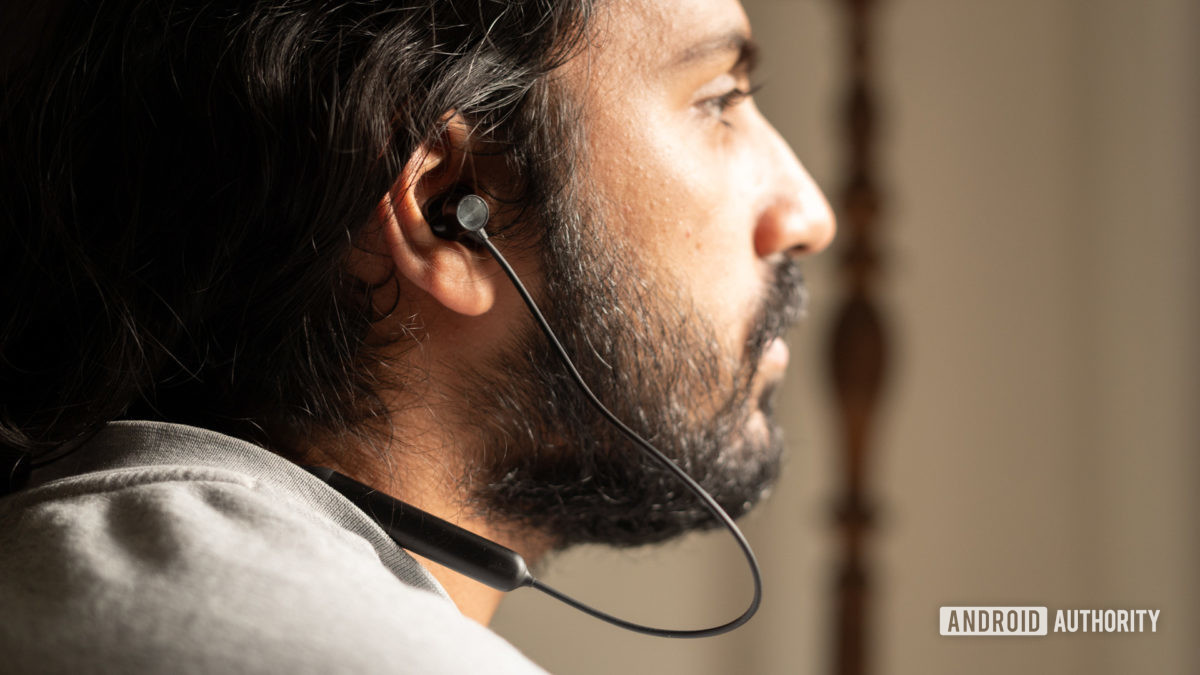 A picture of the OnePlus Bullets Wireless Z in ear worn by a man looking frame-right.