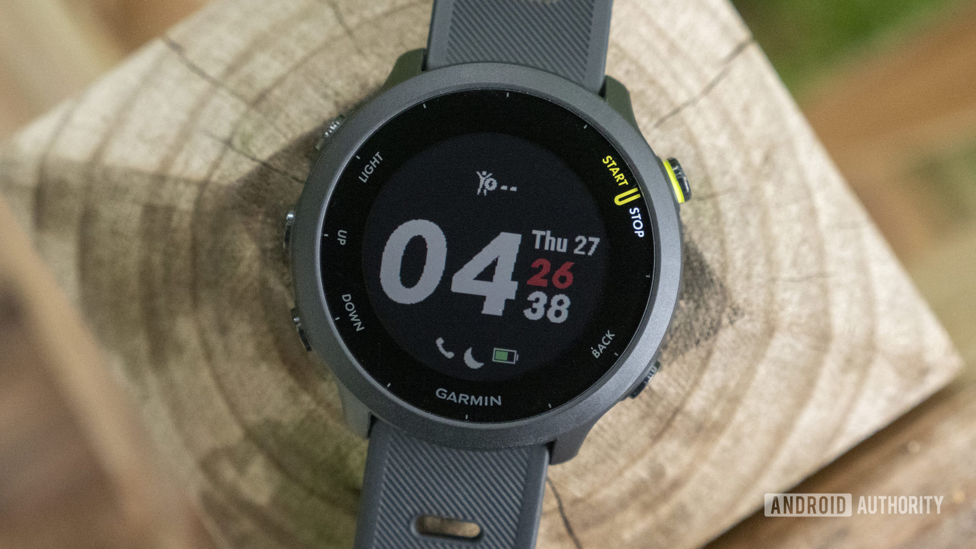 Garmin Forerunner 55 review watch face display on table 1